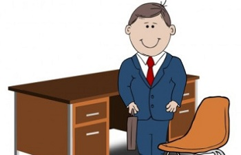 teacher-manager-between-chair-and-desk-6645